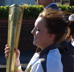 Lorelei Westcott carrying the Olympic torch in Colcot Road, Barry