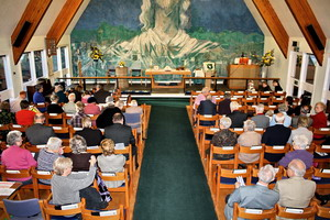The church filling up before a joint service